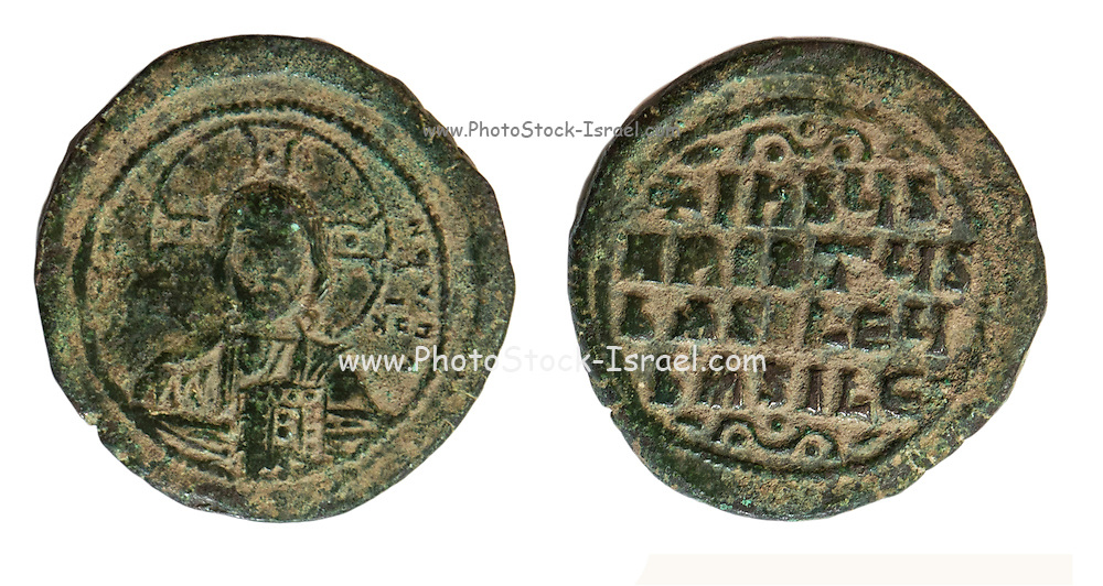 "10-11th century Christian coin with bust of Christ and a Greek inscription ""Jesus Christ King of Kings"" On White Background"