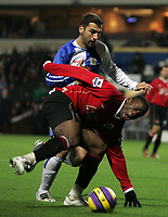 Photo: Paul Thomas.<br /> Blackburn Rovers v Manchester United. The Barclays Premiership. 11/11/2006.<br /> <br /> Zurab Khizanishvili (L) of Blackburn tackles Louis Saha.