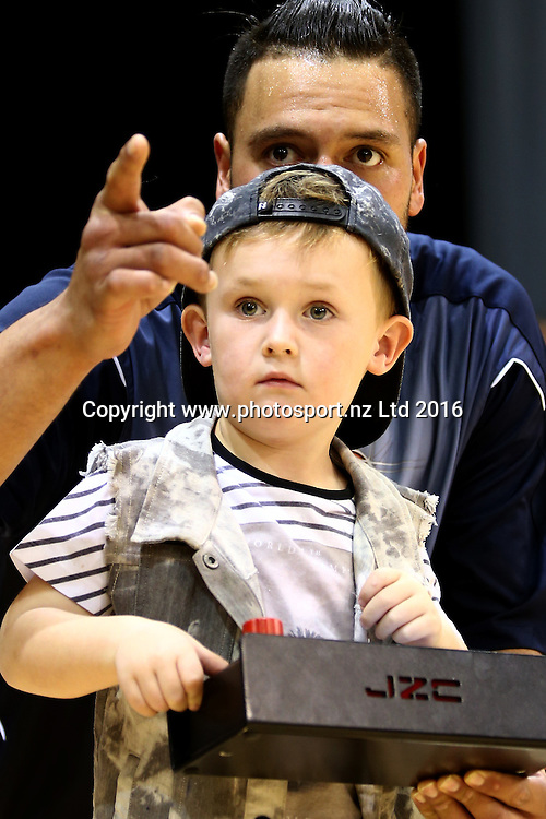 James Paringatai and his son Cooper raise the 2015 championship banner ahead of the NBL basketball match between the Southland Sharks and Nelson Giants, ILT Stadium Southland, Invercargill, Saturday, March 12, 2016. Photo: Dianne Manson / www.photosport.nz