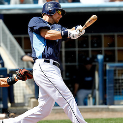 March 21, 2012; Port Charlotte, FL, USA; Tampa Bay Rays second baseman Ben Zobrist (18) hits a fly out against the New York Yankees during the bottom of the third inning of a spring training game at Charlotte Sports Park.  Mandatory Credit: Derick E. Hingle-US PRESSWIRE