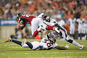 Atlanta Falcons running back Brian Hill (23) battles with Denver Broncos defensive back Trey Marshall (36) and Denver Broncos cornerback Horace Richardson (27) during the Pro Football Hall of Fame Game at Tom Benson Hall of Fame Stadium, Thursday, Aug. 1, 2019, in Canton, OH. The Broncos defeated the Falcons 14-10. (Robin Alam/Image of Sport)