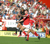 Photo: Jo Caird<br />Charlton v Manchester United at The Valley.<br />13/09/2003.<br />Phil Neville and Matt Holland contest the ball