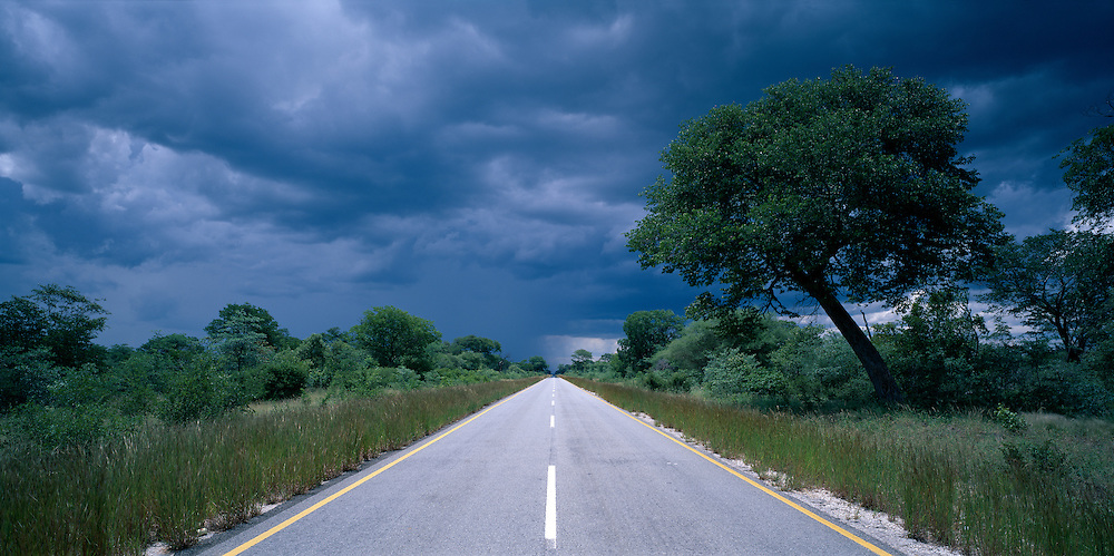 Africa, Botswana, Rainy season storm over abandoned highway north of Francistown