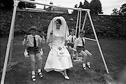 05/07/1967<br /> 07/05/1967<br /> 05 July 1967<br /> Wedding of George Walsh, eldest son of Mr and Ms Kevin G. Walsh, St. Rita's, Firhouse Road, Templeogue, Co. Dublin and Miss Arlene McMahon, elder daughter of Det. Chief Supt. Philip McMahon, Head of Special Branch, Dublin Castle and Mrs McMahon of Lisieux, Templeville Park, Templeogue, Co. Dublin who were married at the Carmelite Church, Terenure College, Dublin. An Taoiseach Mr Jack Lynch and Mrs Lynch; Mr Liam Cosgrave, leader Fine Gael and Mrs Cosgrave were among the 120 guests. Rev Fr H.E. Wright, O. Carm., Moate, officiated at the ceremony. The reception was held at Downshire Hotel, Blessington, Co. Wicklow.  Picture shows Bride and page boys on the swing at the reception.