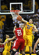 January 27, 2010: Ohio State guard/forward Evan Turner (21) puts up a shot as Iowa guard Eric May (25) defends during the second half of their game at Carver-Hawkeye Arena in Iowa City, Iowa on January 27, 2010. Ohio State defeated Iowa 65-57.