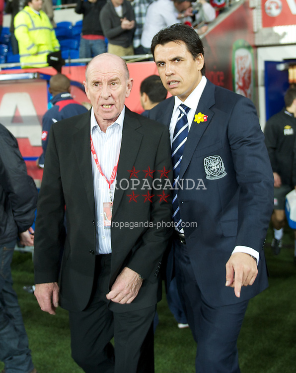 CARDIFF, WALES - Wednesday, February 29, 2012: Roger Speed, father of former Wales manager Gary Speed, stands with Chris Coleman for the national anthem before the international friendly match against Costa Rica at the Cardiff City Stadium. (Pic by David Rawcliffe/Propaganda)