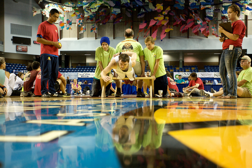 Nick Hanson, 25, competing in the Bench Reach finals at the 2013 World Eskimo-Indian Olympics in Fairbanks, Alaska.