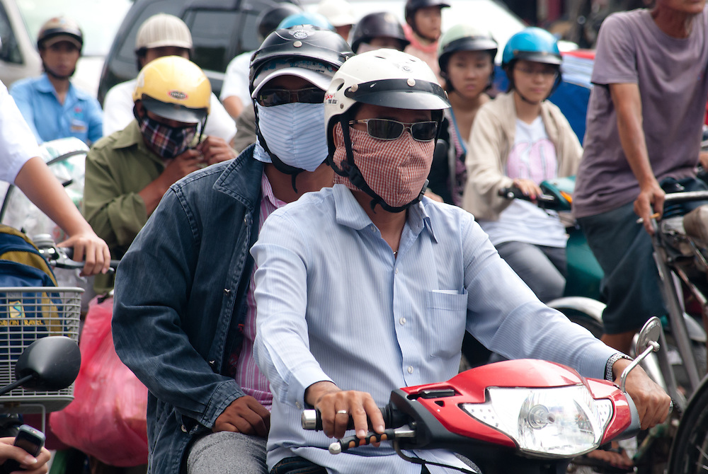 Two boys wearing face mask in polluted Saigon (Ho chi minh city). vietnam