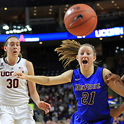 Brooke Schulte, (Centre), DePaul, holds off Kaleena Mosqueda-Lewis, (right), UConn, during the UConn Vs DePaul, NCAA Women's College basketball game at Webster Bank Arena, Bridgeport, Connecticut, USA. 19th December 2014