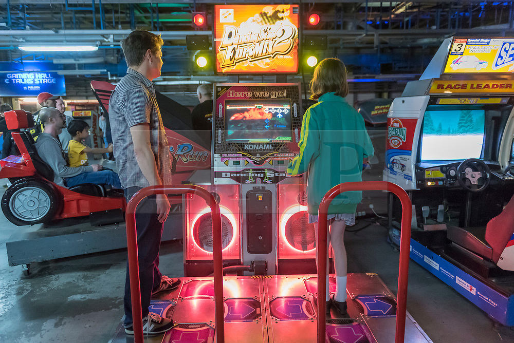 © Licensed to London News Pictures. 12/08/2018. LONDON, UK. People play Dancing Stage at Play Expo London, a video games show featuring consoles, handhelds, computers, vintage arcades and pinball machines, organised by Replay Events taking place at the Printworks in Canada Water, East London.  Photo credit: Stephen Chung/LNP