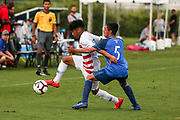 Team USA forward Osvaldo Reyes (7) dribbles the ball away from Team Guatemala midfielder Diego Villatoro (5) during a CONCACAF boys under-15 championship soccer game, Monday, Aug. 5, 2019, in Bradenton, Fla. The USA defeated Guatemala  2-0 (Kim Hukari/Image of Sport)