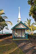 St Peter's by the Sea catholic church is located right on Keauhau Beach with only a dozen pews and a tiny pulpit and a beautiful etched glass window casts soft light over the entire church.  The church was built in 1889 of clapboard with a corrugated tin roof.