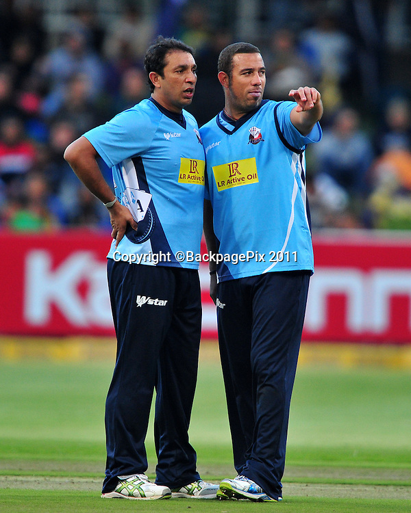 Azhar Mahmood and Andre Adams of the Auckland Aces discuss bowling tactics during the 2012 Champions League Twenty20 cricket match between the Kolkata Knight Riders and the Auckland Aces at Newlands in Cape Town on 15 October 2012 ©Ryan Wilkisky/BackpagePix