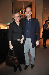 MR & MRS JAMES PALMER-TOMKINSON at a party to celebrate the launch of Simon Sebag-Montefiore's new book - 'Jerusalem: The Biography' held at Asprey, 167 New Bond Street, London on 26th January 2011.