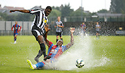 Jerome Binnon-Williams making quite the splash with a challenge during the Pre-Season Friendly match between Tooting & Mitcham and Crystal Palace at Imperial Fields, Tooting, United Kingdom on 24 July 2015. Photo by Michael Hulf.