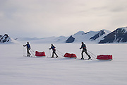 Travelling across the ice cap during a British mountaineering expedition to Knud Rasmussens Land, East Greenland, Arctic, 2006.