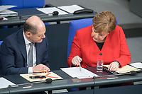 21 MAR 2019, BERLIN/GERMANY:<br /> Olaf Scholz (L), SPD, Bundesfinanzminister, Angela Merkel (R), CDU, Bundeskanzlerin, im Gespraech, Bundestagsdebatte zur Regierungserklaerung der Bundeskanzlerin zum Europaeischen Rat, Plenum, Deutscher Bundestag<br /> IMAGE: 20190321-01-066<br /> KEYWORDS: Gespräch