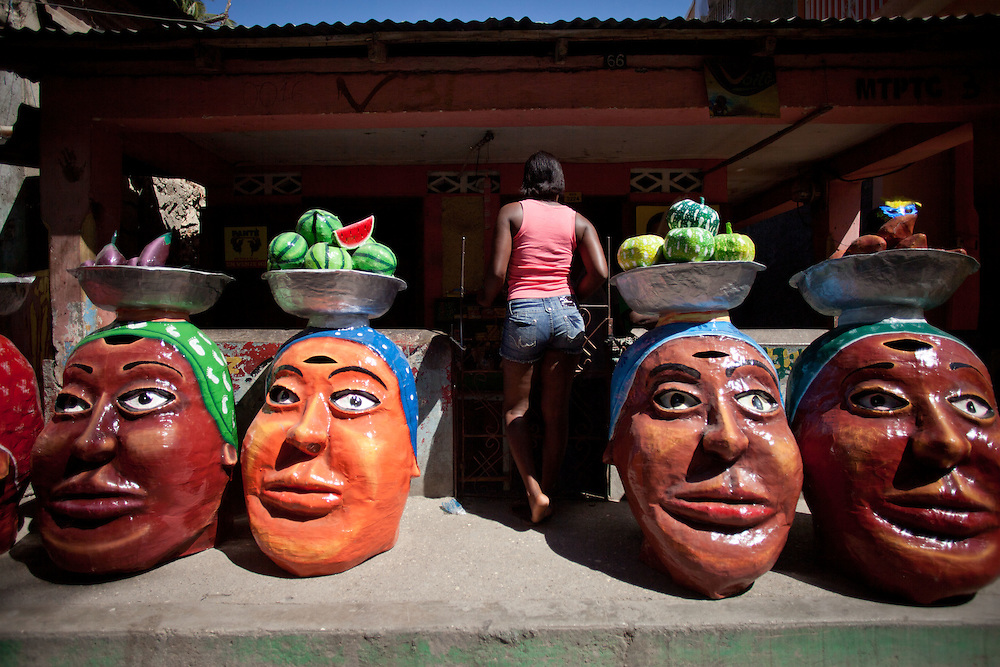 The carnival celebrations in Jacmel are famous for intricate paper mache masks and street theater. Carnival celebrations did not happen last year in Haiti becuase of the January 12th earthquake. For many of the artisans in Jacmel the revenue from carnival is their primary source of income./// Paper Mache masks are lined up before the big carnival parade.