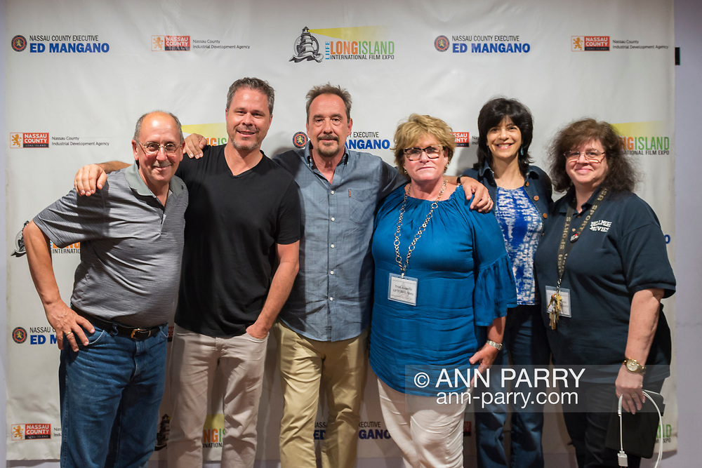 """Bellmore, New York, USA. 19th July 2017.  L-R, HENRY STAMPFEL, BRAD KUHLMAN, LOU DiMAGGIO, TRISH APPELLO, Maria Pusateri, and ANNE STAMPFEL pose during final Screening Night of Long Island International Film Expo 2017 at Bellmore Movies. The last film screened was the feature documentary """"Where Have You Gone, Lou DiMaggio?"""" by Director Brad Kuhlman about comedian Lou DiMaggio contemplating a comeback after 20 year away from stand-up comedy. Henry and Anne Stampfel are the owners the Bellmore Movies, and two of the co-founders of LIIFE. Henry Stampfel is President Chairman Treasure and Trish Appello is Secretary of the Long Island Film/TV Foundation which, along with Nassau County Film Commission presented LIIFE 2017."""