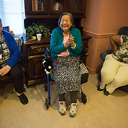 MANASSAS, VA - NOV21:  Rosa Valqui, 89, dances in her seat to karaoke at Birmingham Green, an elder care residence in Manassas, VA, November 21, 2014. With the U.S. population aging and Alzheimer's more widespread, science is looking for ways to slow or delay the onset of dementia in aging Americans. Among the approaches is trying to determine whether art, music and dance or movement can also alleviate the problems attendant with dementia. The federal government is funding a study at Birmingham Green with George Mason University to see whether there is a scientific basis to believe that art is actually medically beneficial. (Photo by Evelyn Hockstein/For The Washington Post)