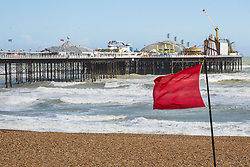 © Licensed to London News Pictures. 06/06/2017. Brighton, UK. Gale force winds have been hitting the seaside resort of Brighton and Hove throughout the day. Danger signs and red flags have been warning visitors to stay away from the water. Photo credit: Hugo Michiels/LNP