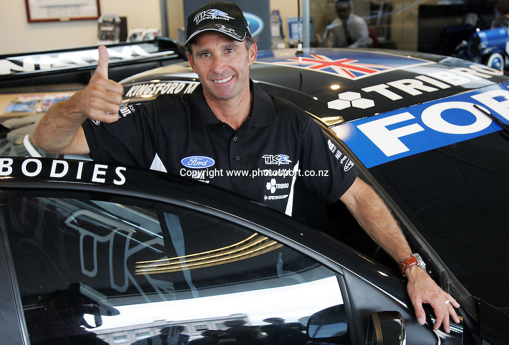 Team Kiwi driver Paul Radisich in front of the new Team Kiwi V8 racing car on show at John Andrew Ford, Auckland, New Zealand on Monday 12 February 2007. Photo: Hannah Johnston/PHOTOSPORT<br />