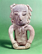 Pottery figure from Vard Cruz: Mexico Totoniac Abbey Museum.