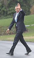 President Barack Obama waves as he walks to Marine One on his way to Strongsville, OH on March 15, 2010.  Photograph by Dennis Brack