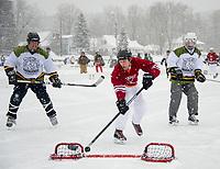 Tournament action on Meredith Bay for the New England Pond Hockey Classic.  (Karen Bobotas Photographer)