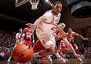 25 February 2010: Indiana forward Christian Watford (2) dives for the ball in front of Wisconsin forward Keaton Nankivil (52)  as the Indiana Hoosiers played the Wisconsin Badgers in a college basketball game in Bloomington, Ind.