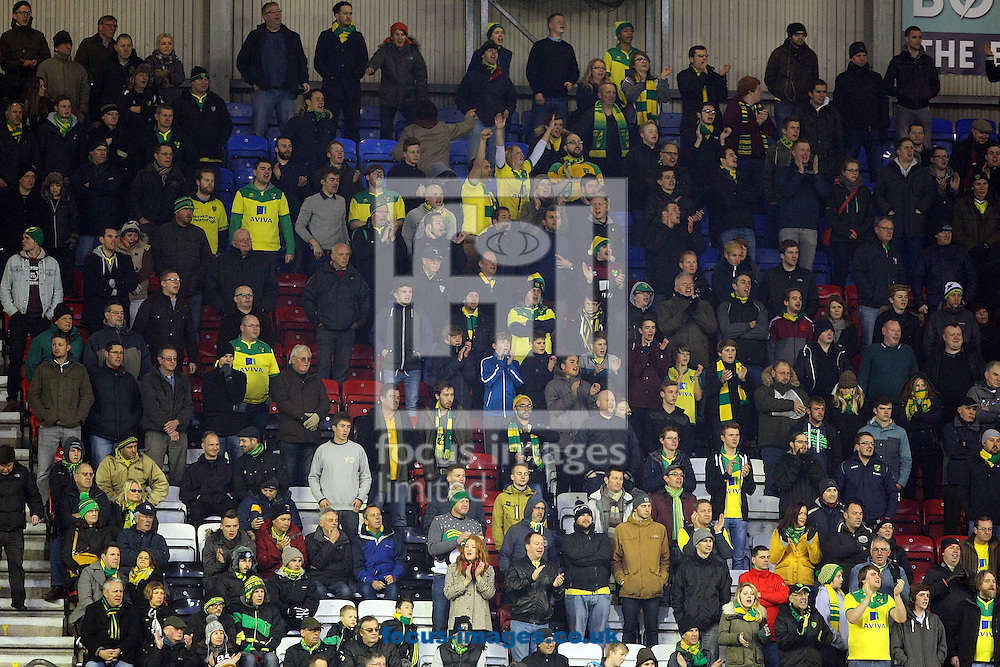 The traveling Norwich fans during the Sky Bet Championship match at the DW Stadium, Wigan<br /> Picture by Paul Chesterton/Focus Images Ltd +44 7904 640267<br /> 06/12/2014