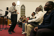 Julius Dicks enthusiastically leads the choir during a rehearsal for the 2017 Gospel Songfest in Rochester on Tuesday, January 10, 2017.