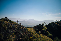 Munnar, India -- February 16, 2018: Hikers look out over the great landscape of the Western Ghats in Kerala.