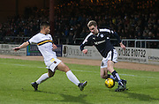 Dundee&rsquo;s Kevin Holt runs at Dumbarton&rsquo;s Kler Heh- Dundee v Dumbarton, William Hill Scottish Cup Fifth Round at Dens Park<br />