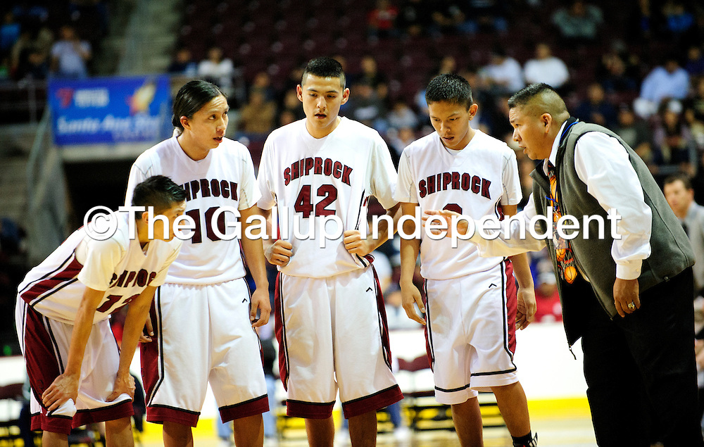 031313  Adron Gardner/Independent<br /> <br /> Shiprock Chieftain varsity basketball coach Chester Atcitty, left, gives the Chieftains a talk in the final minutes against the Portales Rams during the 3A New Mexico High School Basketball tournament quarterfinals at Santa Ana Star Center in Rio Rancho Wednesday.