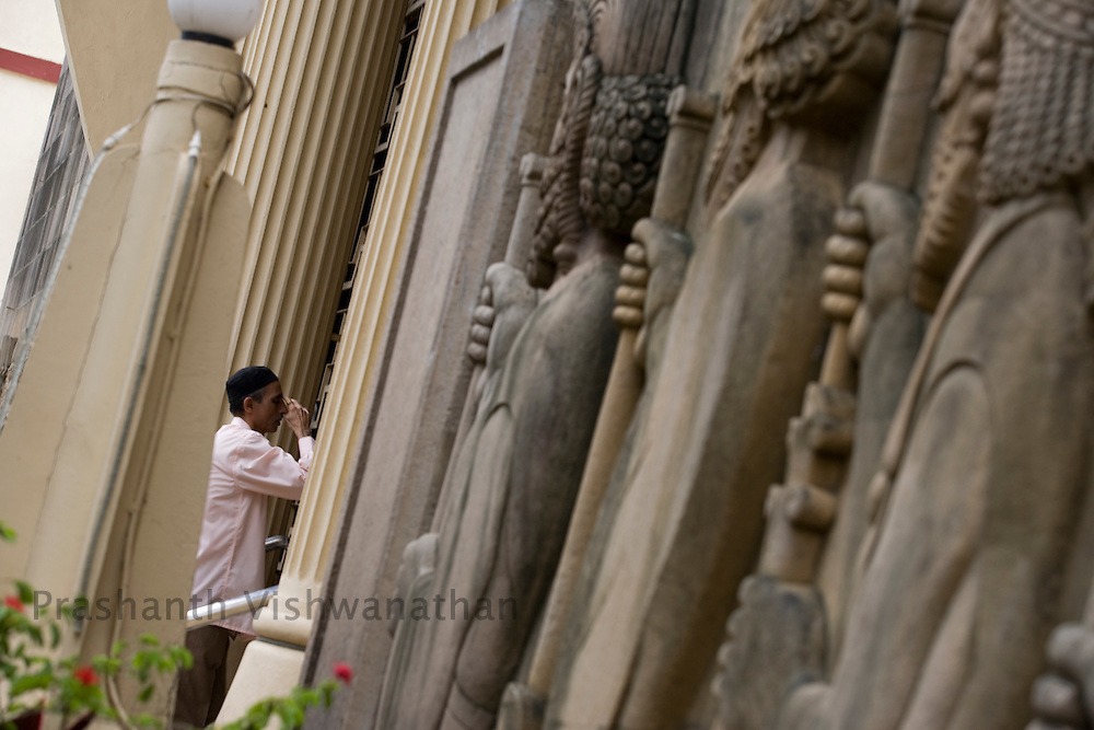 A Parsi man prays as he enters the Kappawala Agiary, or Fire Temple, on Navroze, the Parsi new year, in Mumbai, India, Tuesday, Aug. 19, 2008. Parsis, also known as Zoroastrians, worship fire and are followers of the Bronze Age Persian prophet Zarathustra. According to estimates there are only 150,000 Zoroastrians in the world today and more than 80,000 live in India, mostly in Mumbai. Photographer:Prashanth Vishwanathan/Atlas Press