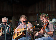Sam Bush with Jack Lawrence and Doc Watson in the background at Merlefest 2009 2009-04-25