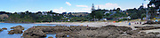 Panoramic view of people enjoying Palm Beach, Mawhitipana Bay, Waiheke Island, New Zealand.