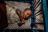 During my collaboration with an UNESCO program, I went several times in Africa, including Rwanda<br /> Here are some photos of these different missions, mostly with regard to orphans of Rwanda and the mission with Marie Jose Perrec and Marie Jose Lallart (UNESCO)<br /> Here, baby in an orphanage, Kigali.<br /> In this small country, 26 338 km2 for 11 millions persons , rapes are still very common.<br /> Rwandans violate  Congoleses, Ugandans violate Rwandans...  everyone violates everyone ... and the abandonments of children are very numerous.