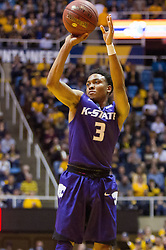 Feb 11, 2017; Morgantown, WV, USA; Kansas State Wildcats guard Kamau Stokes (3) shoots a three pointer during the first half against the West Virginia Mountaineers at WVU Coliseum. Mandatory Credit: Ben Queen-USA TODAY Sports