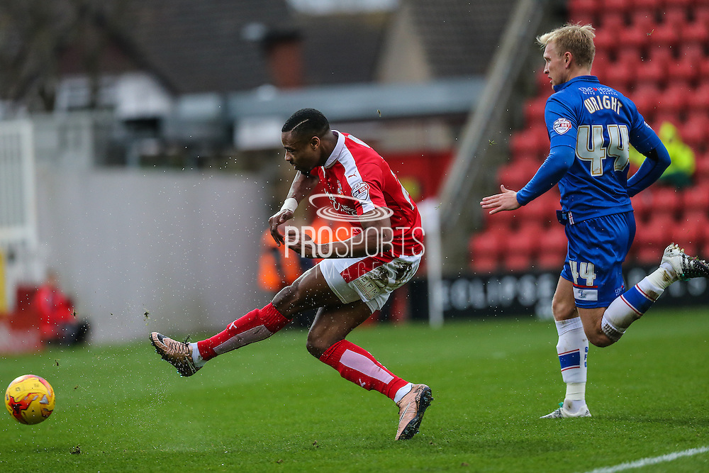 Swindon Town's Jonathan Obika shoots to put Swindon 1 nil up during the Sky Bet League 1 match between Swindon Town and Gillingham at the County Ground, Swindon, England on 26 December 2015. Photo by Shane Healey.