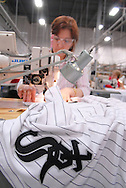 4/3/09 10:46:09 AM -- Easton, PA, U.S.A. -- Djoumile Pendeva, a seamstress at Majestic Athletic sews lettering on the back of a Chicago White Sox jersey April 3, 2009 in Easton, Pennsylvania. White Sox jerseys and gear have experienced a boost in sales with Obama, a White Sox fan, in the White House. -- .Photo by William Thomas Cain,  cainimages.com.