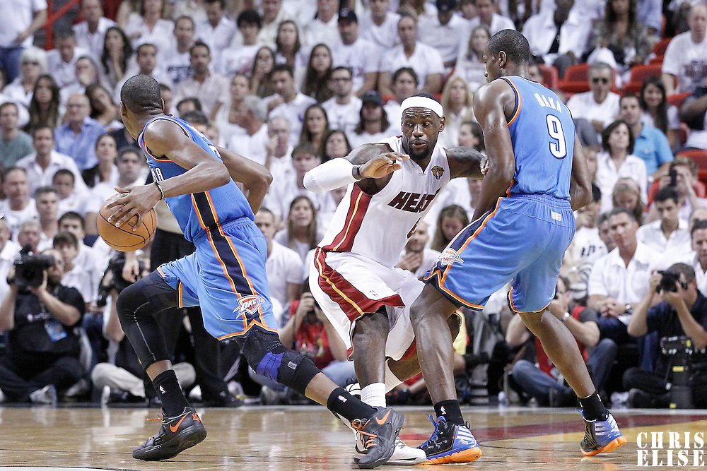 19 June 2012: Oklahoma City Thunder small forward Kevin Durant (35) drives past Miami Heat small forward LeBron James (6) on a screen set by Oklahoma City Thunder power forward Serge Ibaka (9) during the Miami Heat 104-98 victory over the Oklahoma City Thunder, in Game 4 of the 2012 NBA Finals, at the AmericanAirlinesArena, Miami, Florida, USA.