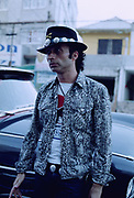 Man in a crocodile jacket leaning against a car, Brazil, 2000's