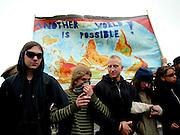 """Rostock   June 2, 2007   ..Mehr als 50000 Menschen demonstrieren in Rostock gegen den G8-Gipfel in Heiligendamm, gegen Kapitalismus, Militarismus, Krieg und gegen die Politik der G8-Staaten. HierHier, am Stadthafen Rostock: Demonstranten mit einer auf dem Kopf stehenden Weltkarte, beschriftet mit """"Another World Is Possible"""" (Eine andere Welt ist m?glich)...More than 50000 people take part in a demonstration in the german city of rostock against the G8-summit in Heiligendamm, against capitalism, militarism, war and the politics of the G8 states. Here, at the Rostock city harbour: Demonstrators with an upside-down map of the world on wich is written """"Another World Is Possible""""...20070602g8 ...[Inhaltsveraendernde Manipulation des Fotos nur nach ausdruecklicher Genehmigung des Fotografen. Vereinbarungen ueber Abtretung von Persoenlichkeitsrechten/Model Release der abgebildeten Person/Personen liegen nicht vor.]"""