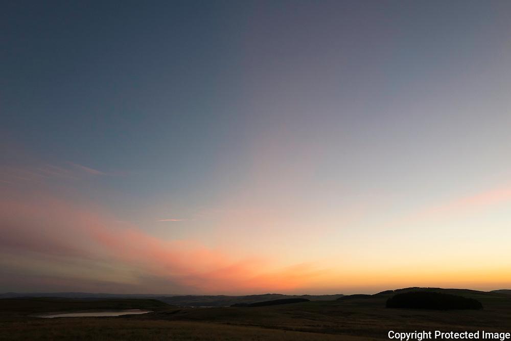 Whitton Edge, Hownam, Jedburgh, Scottish Borders, UK. 17th September 2016. Sunrise over Whitton Loch lloking east towards Morebattle.