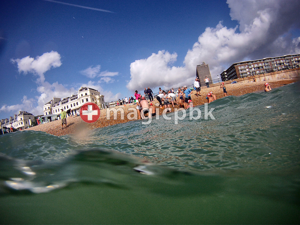 Swimmers drink during a break in a training session at the harbour in Dover, Great Britain, Sunday, Aug. 18, 2013. Gino Deflorian tries to become the first Swiss male swimmer who successfully swims the English Channel form Dover/Folkestone to Calais, France. (Photo by Patrick B. Kraemer / MAGICPBK)