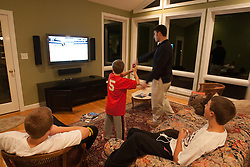 29 November 2007: North Carolina Tar Heels men's lacrosse Chris Cortina plays Nintendo Wii with Grant Haus during the junior dinner at the house of coach John Haus in Chapel Hill, NC.