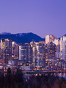 City skyline and north coast mountains at twilight, Vancouver, British Columbia, Canada.