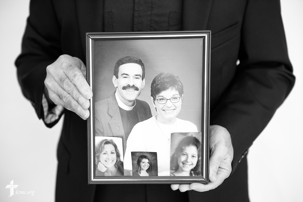 #EyesofLife Portrait of the Rev. Kevin A. Karner, pastor of Immanuel Lutheran Church, holding a photograph of his wife Maggie Karner, who died in 2015, and their daughters, on Tuesday, Nov. 1, 2016, in Bristol, Conn. LCMS Communications/Erik M. Lunsford